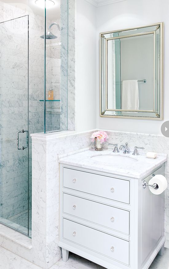Elegant small bathroom (1 of 2). I love the shower design, which makes the compact space look bigger thanks to the clear glass panel in the side wall, and of course the beautiful mirror and marble tile ~ Epi (from StyleatHome)