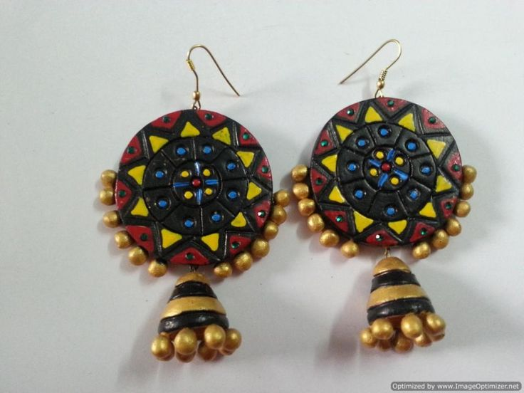 Big Circle design with lined jhumki.. Pair them with a beautiful saree for that bold and beautiful look. For more details visit at : http://www.indiebazaar.com/product/53730/terracotta-black-big-circle-with-jhumki