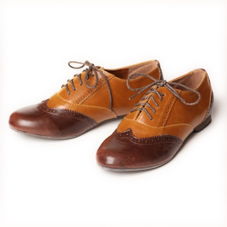 """""""Rae"""" jazz oxford shoes in tan $32.99 The tan and brown tones give these oxford jazz shoes a unique little twist. They have 2 - colored leatherette uppers, lace up fronts, perforated and stitching details. The insoles are cushioned for maximum comfort.  - Man Made Materials - 0.5"""" heel - Synthetic Sole"""