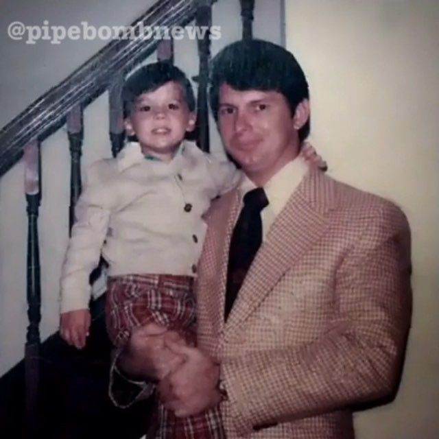 Classic picture of Vince McMahon holding his son Shane McMahon #WWE