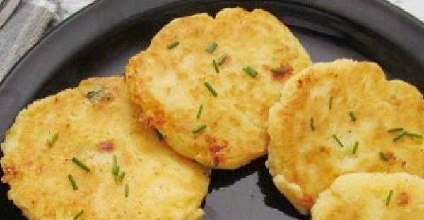 Potato Patties 4 cups of mashed potatoes 1 egg 1 green onion, sliced 1 cup of cheddar cheese, grated 1 cup of flour butter salt and pepper chives for garnish, if desired 1. Combine mashed potatoes, onion, egg, cheese, flour in a large bowl 2. Spoon up about 1/3 cup of the mixture, shape into balls 3. Roll each into flour and flattened into patties 4. Melt butter in large skillet over medium heat 5. Fry each patty in the skillet about 5 minutes each side until golden brown