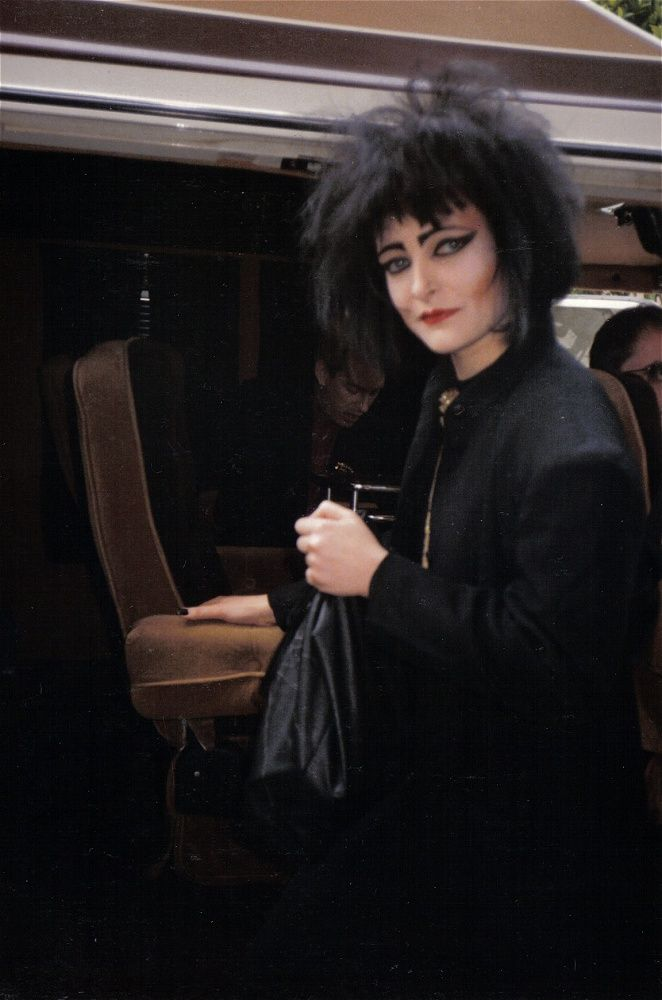 English singer Siouxsie Sioux in 1986 wearing black clothing, back-combed hair, and heavy black eyeliner. She was an inspiration for the gothic fashion trend that started in the early 1980s