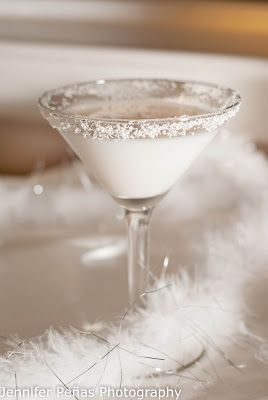 White Snow Chocolate Martini (2 oz vanilla vodka 1/2 oz white creme de cacao 1 oz Godiva white chocolate liqueur)