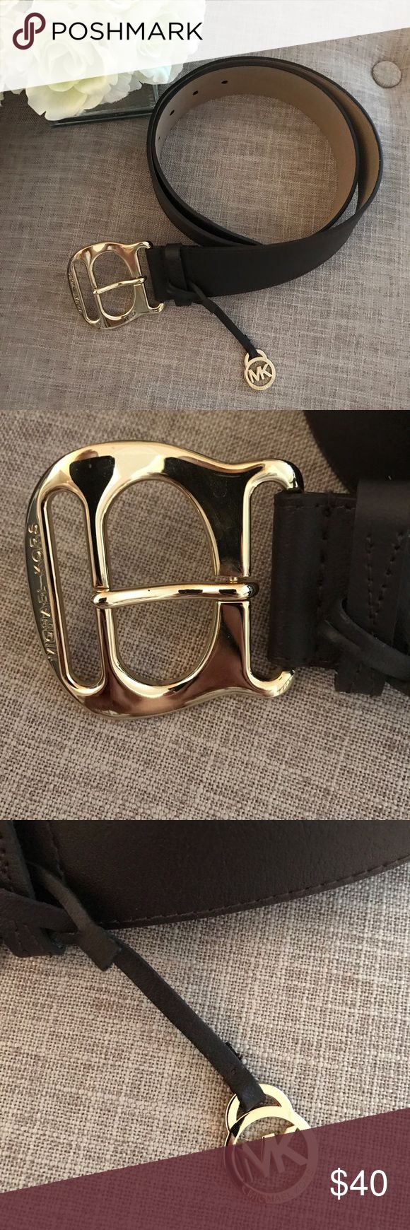MK brown and gold leather belt Worn once. Dark chocolate brown with gold buckle and charm. No wear or scratches. In perfect condition! From a pet free and smoke free home. Like this item? MAKE ME AN OFFRER! Michael Kors Accessories Belts
