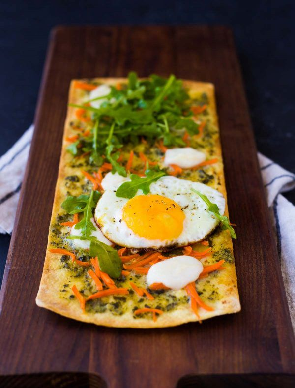 This pesto flatbread pizza is the perfect thing to get you out of your lunch rut. Ready in 15 minutes, it's a quick and easy way to have a flavorful and filling lunch. Get the recipe on RachelCooks.com!