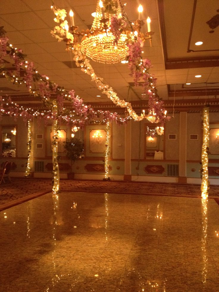 Fairy lights and vines over the dance floor for an Enchanted Forest themed prom