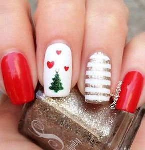 Gorgeous nail art perfect for Christmas! Love the red nail color. Love the Christmas tree with hearts on a background of white. Loving the striped nail too. #nailart #Christmas #nails #holidays #Christmastree