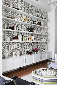 Floating shelves Fill the whole space with equal length shelves--not small, irregularly spaced ones--and backed w/maple