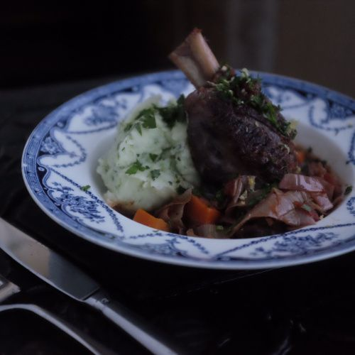 Slow-cooked lamb shanks topped with gremolata and served with a parsley mash.