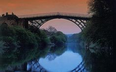 The Iron Bridge, Telford & Wrekin, England. The iron bridge was the first of its kind in the world, spanning the River Severn and linking towns near the cradle of the Industrial Revolution