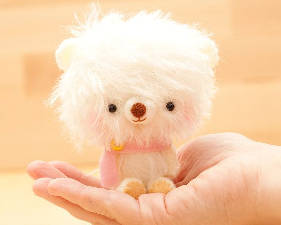 Pinu is a very soft and fuzzy amigurumi crocheted and sewed teddy bear. She is made of white mohair and yarn with safety eyes and stuffed with
