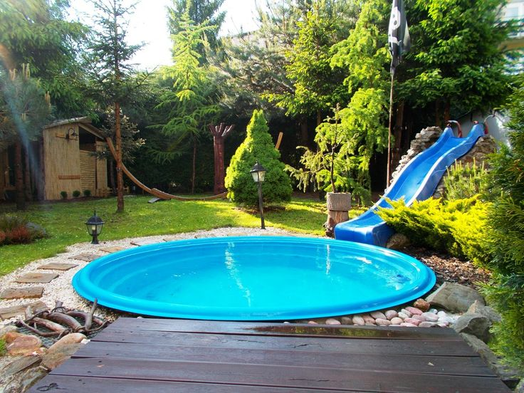 swimming pool intex swimming pool design ideas with round fiberglass pool and foliages around the pool
