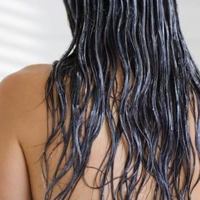 Use hot oil to infuse dry hair with much-needed moisture.