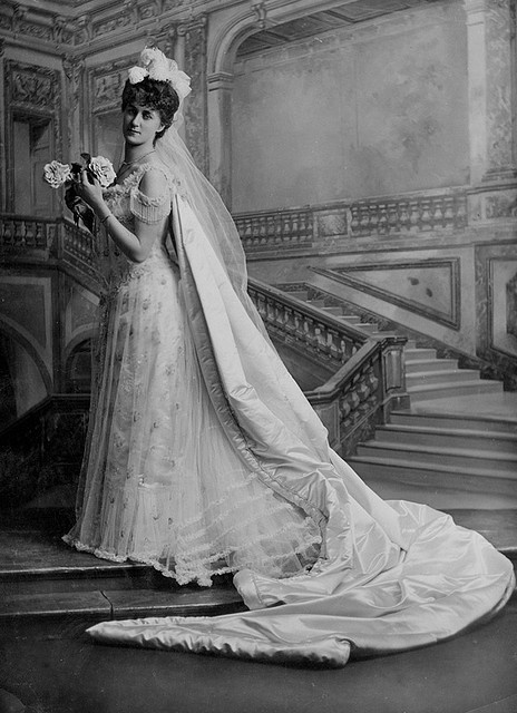 A debutante wearing the three white feathers of the Prince of Wales
