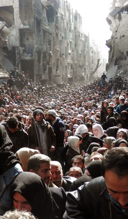 hawamisch:This is the mass exodus of people from Yarmouk, a Palestinian refugee camp in Damascus that has been under siege by the Assad government and military since 2013. Yarmouk, where ISIS is now trying to make theirs. That is the victim of barrel bombs launched by a brutal regime.