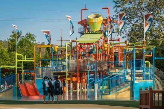Wet 'n' Wild: Multilevel interactive play structure with a giant tipping bucket!