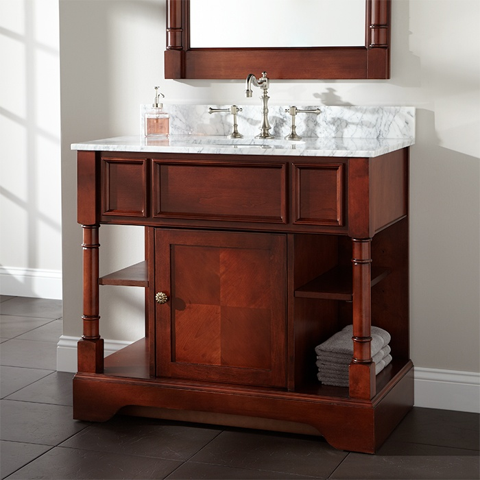 Traditional bathroom vanity cabinet with marble countertop