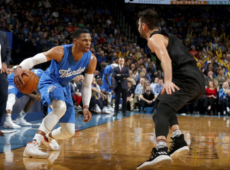 Oklahoma City's Russell Westbrook (0) looks to drive to the basket past Minnesota's Ricky Rubio (9) during the NBA game between the Oklahoma City Thunder and the Minnesota Timberwolves at the Chesapeake Energy Arena,  Sunday, Dec. 25, 2016. Photo by Sarah Phipps, The Oklahoman
