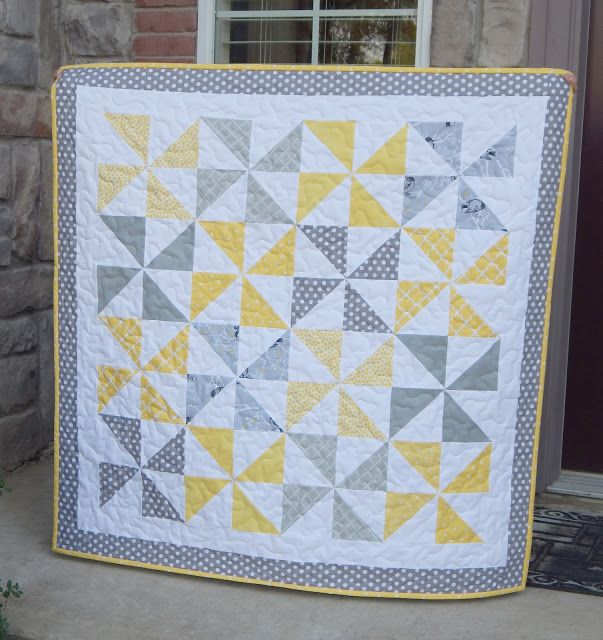 40 x 40 I finished this simple baby quilt this week.  Yellow and Gray is so nice and soothing together, especially for a baby quilt. I cut 2 - 5 inch squares for each pinwheel from each the print and