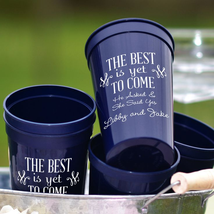 22 Oz navy stadium cups printed with RHD06 design and 3 lines of custom print in Precious lettering style and White imprint