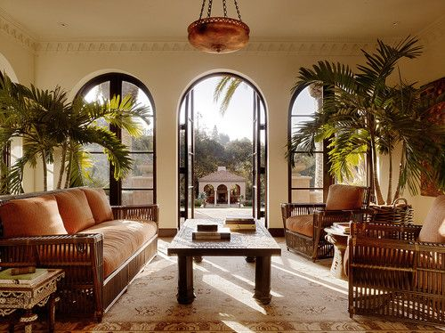 Mix in exotic global pieces. These traveling Brits loved to return with exotic items like bone inlay tables from India. Palm trees and rattan furniture complete the look.