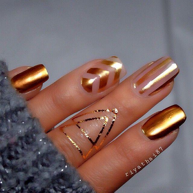 Gold negative space nail art