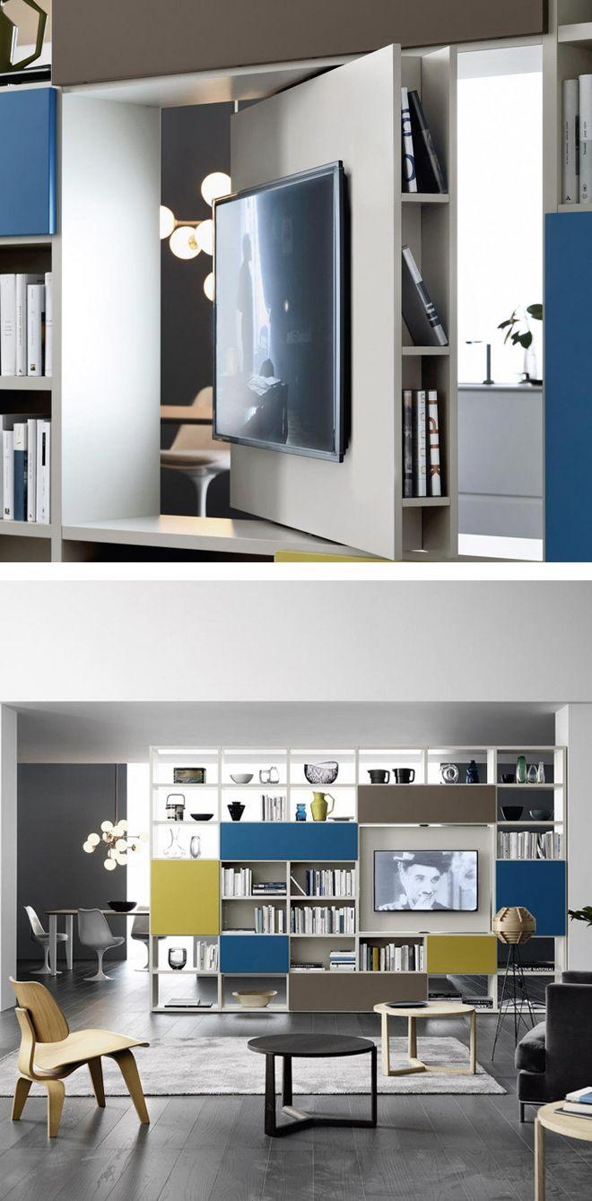 Das Livitalia Bücherregal C90 hat ein drehbares TV Paneel und kann auch sehr gut als Raumteiler eingesetzt werden.  #Regal #Bücherregal #Raumteiler #TV #modern #minimalistisch #Wohnzimmer #livingroom #frame #shelf #bookcase #inspiration #Einrichtungsideen #wohntrend #wohnstil #interiordesign #interiordecorating #home #wohnen #einrichten #Design #Möbel