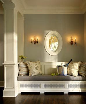 Classical columns were added in the revamped entrance hall to visually separate the stair hall from this small vestibule with built-in seating.