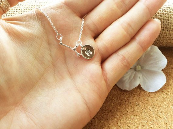 This customised Aries and initial charm necklace.