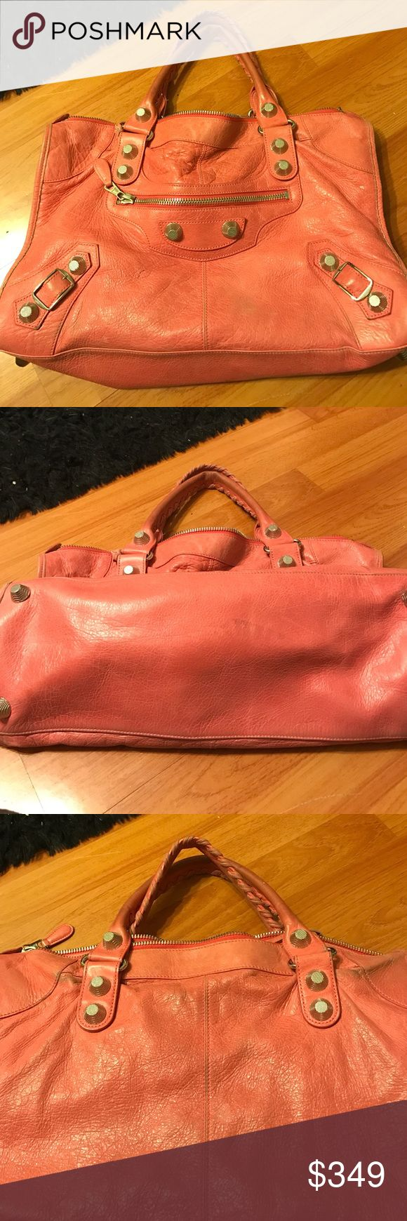 Balenciaga Motorcycle Bag Authentic Balenciaga Motorcycle Bag in salmon pink color. Great bag and holds a lot of stuff. Has a few stains and the handles are worn (pictures uploaded of this). Steal at this price! Balenciaga Bags Totes