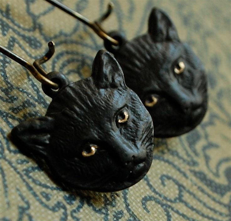 the familiar - eerie black cat brass earrings. $24.00, via Etsy.