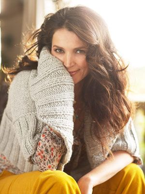 julia ormond in big sweater with flowered blouse and yellow cords
