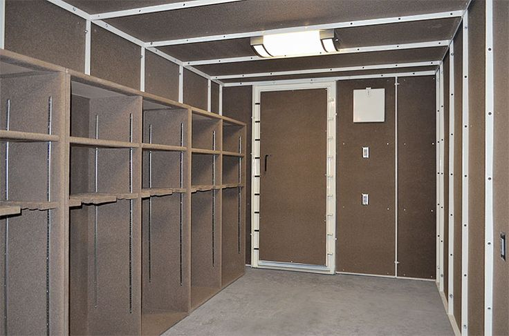 Very Large Safe Room And Tornado Shelter Interior. Showing Out Swinging  Door, Gun Racks, Shelving And Lighting And Electrical.