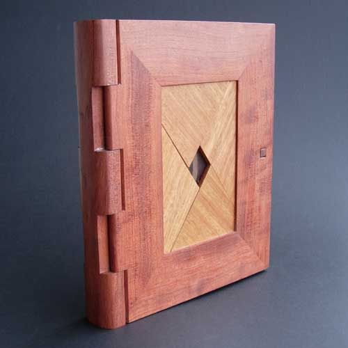 Here's another beautiful bit of wooden puzzle design and craftsmanship from Denver metagrobologist Kagen Schaefer. The locking mechanism was recently reverse-engineered by Instructables user dombeef, who has made a working paper version.