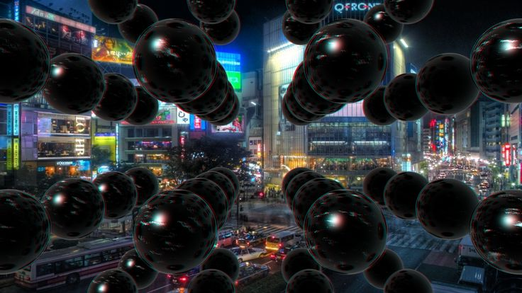 An experiment in Stereographics (if that is even a word!).  Anaglyph spheres rendered in front of a 2D backgound of a Tokyo street scene.
