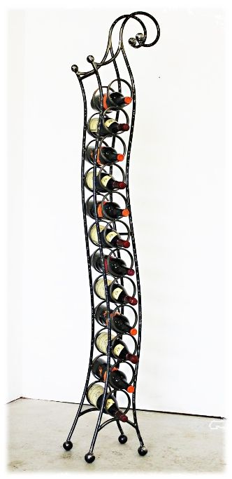 Passionelle Transitional Floor Wine Rack 12 Bottle Make a statement. in any room of the home. Each of our handcrafted wine racks is a unique and distinctive way to display your wine collection. Choose from five available finishes: Steel, Copper, Gold, Red and Black - Shown in the Clear finish. These wine racks are made to order specifically for you in the USA.