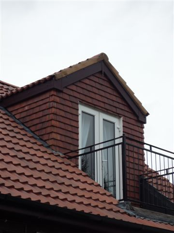 A Pitched Roof Dormer With Walk Out Bacony Attic Remodel