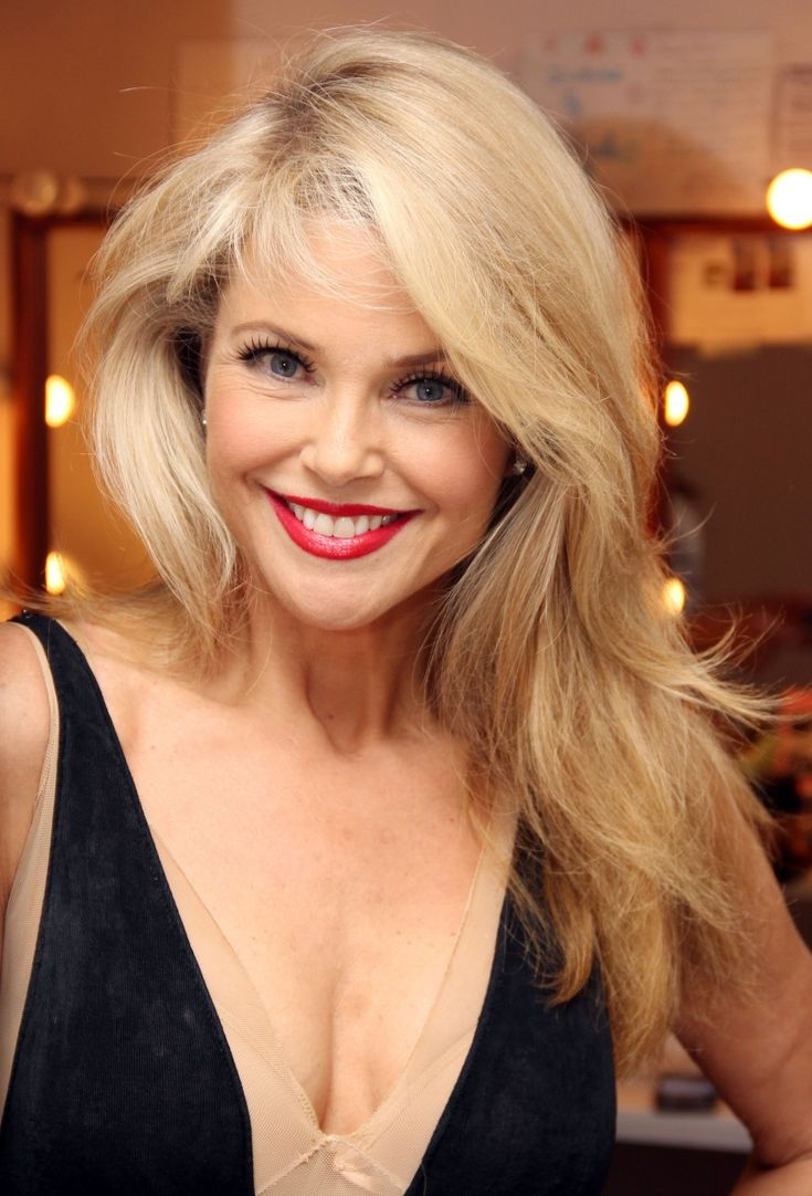 Christie Brinkley 60 years old people! Looks young and amazing!  Either she's perfect or they did a great job on her, unlike many other cases of plastic surgery....