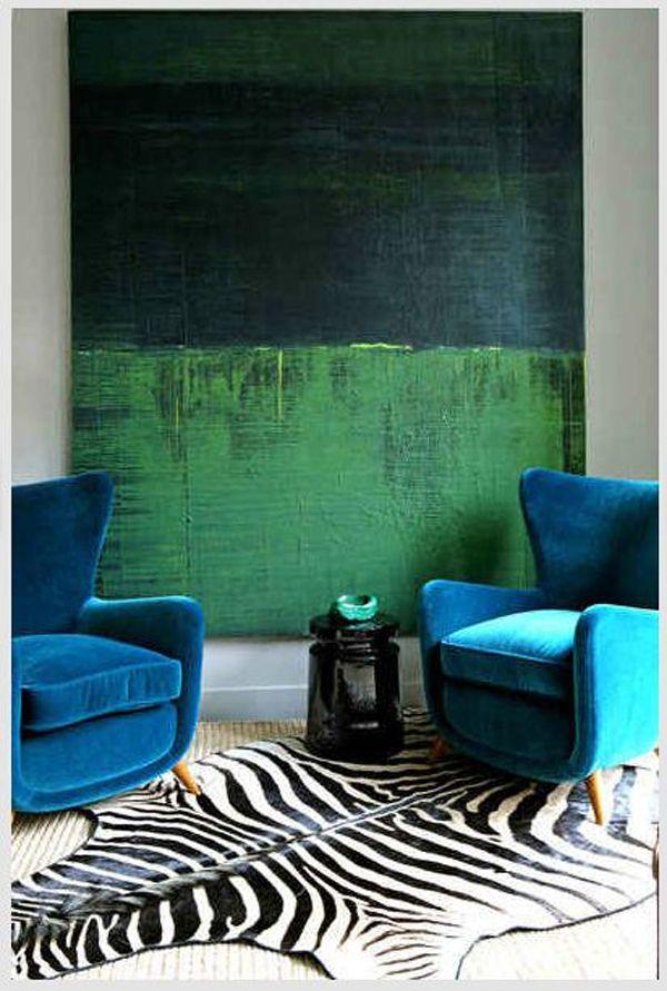 luxe velvet blue seating, zebra prints + emerald wall art