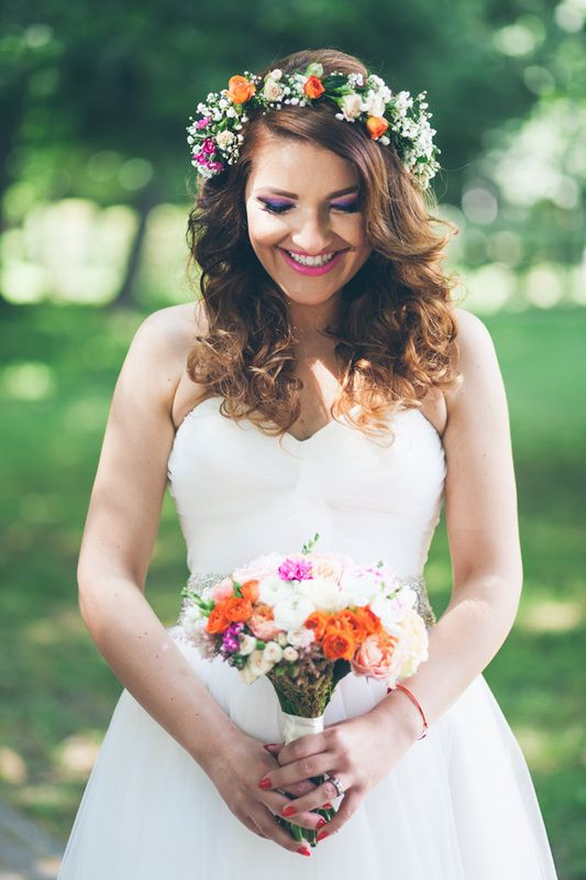 Bride with wreath and bouquet