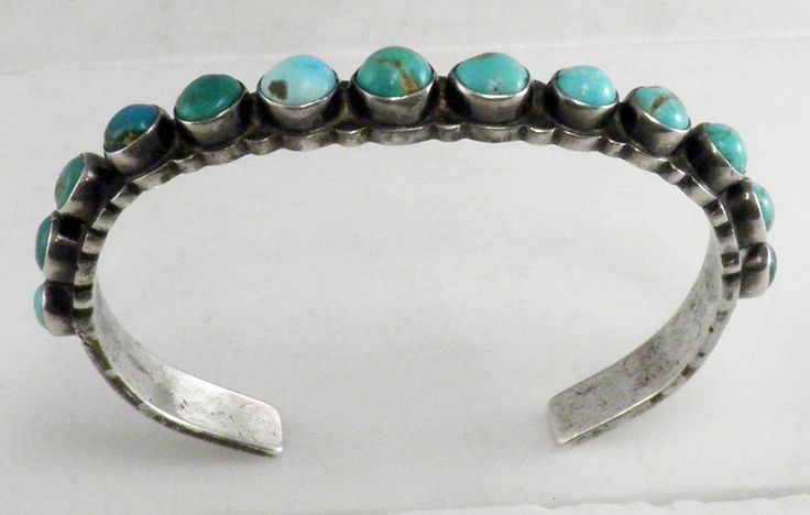 Early Navajo – Sterling Silver with 13 Turquoise Row Bracelet – C. 1920s)