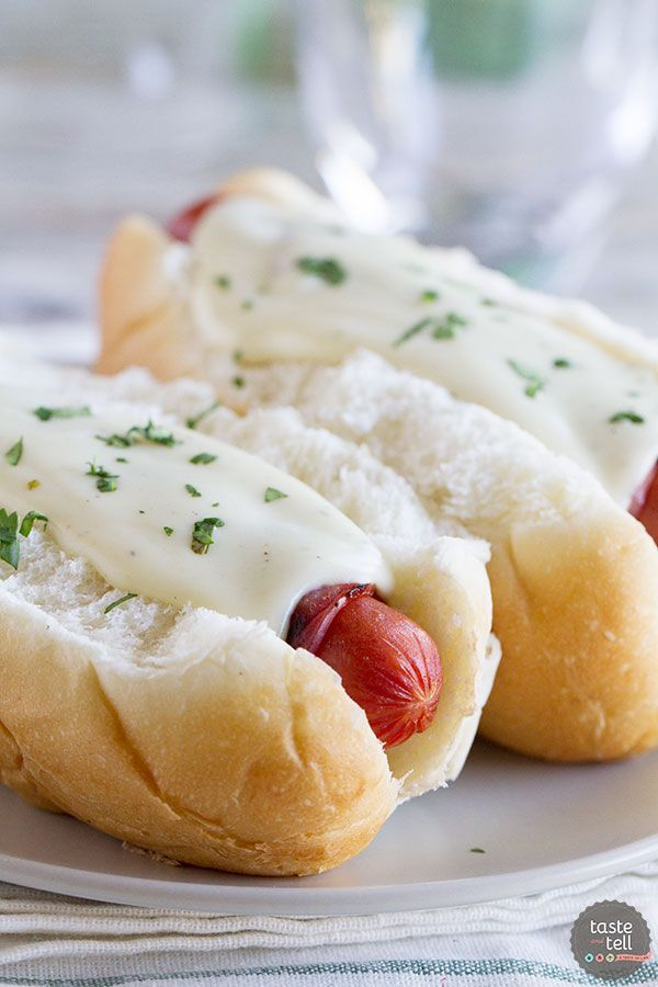 Cordon bleu doesn't have to mean fancy - these Cordon Bleu dogs have hot dogs wrapped in ham and then topped with a creamy Dijon cheese sauce.