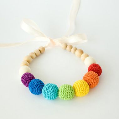 Rainbow Nursing Necklace -  This colorful nursing necklace provides a lot of joy and cheer! Wearing a mommy necklaces and being a mom make a fantastically awesome pair! It is a simple way to elevate the everyday mommy-combo of jeans and t-shirt!  Also a mommy necklace keeps little fingers occupied and keeps curious babies and toddlers from playing with hair or clothing instead! It is a perfect baby teether.