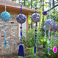 Handmade windchimes... all one of a kind! Mirror & stained glass, made to withstand the heartiest of winds! Beautiful in the sun, & beautiful around the home! She also takes special requests (i.e. specific colors or designs)... Gardencandybycandy.com