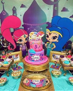 Look at this amazing Shimmer and Shine birthday party spread with an incredible cake, character cutouts, yummy cupcakes and more!