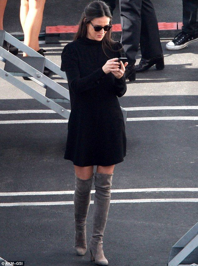 Sending in her vote! Demi was locked to her smartphone as she sashayed around backstage on...