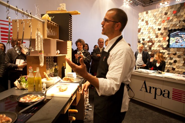 Chef Andrea Provenzani experiencing the Curiosity Kitchen made of Naturalia. Milan Design Week 2010.