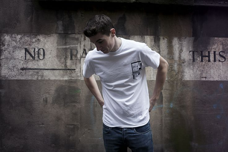 Lewis wears the 'Home' T-Shirt in white/medium.