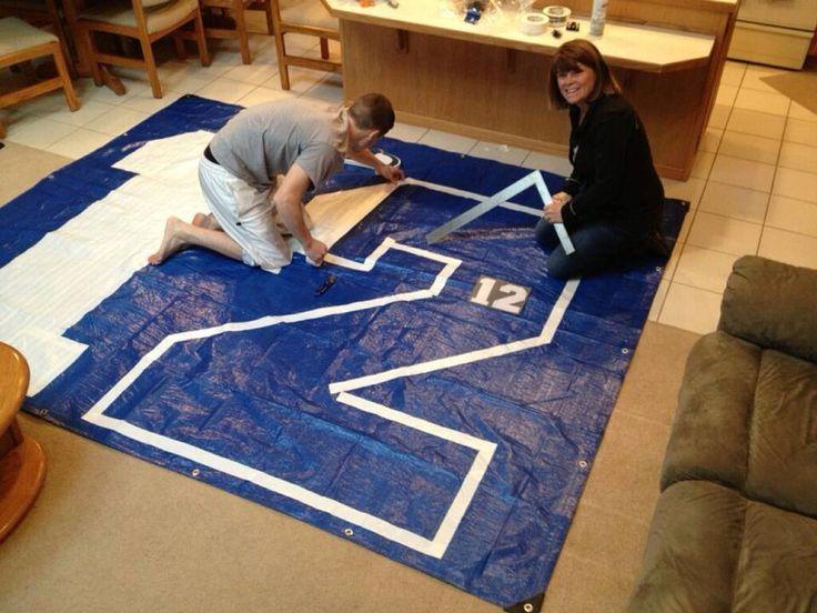 DIY 12th man flag. 1 tarp, 2 rolls of white duck tape