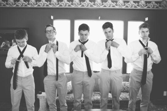 like b phoot of groomsmen getting ready